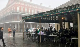 A jazz band plays in front of Cafe du Monde on a foggy morning in New Orleans.